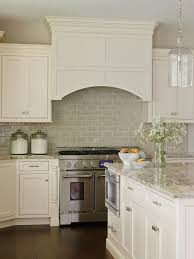 See the beautiful neutral subway tile backsplash in this kitchen with a  built-in range