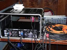 "cheap advice on music  blog archive  a basic live sound setup setup at a typical rusty strings gig the effects box and the very heavy power amp are mounted in a ""portable"" rack the snake 100′ is wound on a"