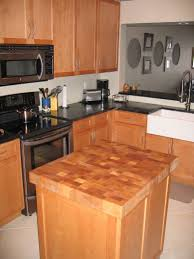 butcher block kitchen island featuring brown color wooden kitchen smlfimage source