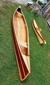 wooden canoes as many canoes were under construction need a clamp
