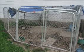 this outdoor dog run needs a new top and a good kennel flooring solution