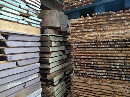 stack of scottish timber used in custom hand crafted bespoke commission furniture by namon gaston