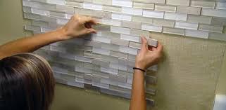 installing backsplash tile using an adhesive mat