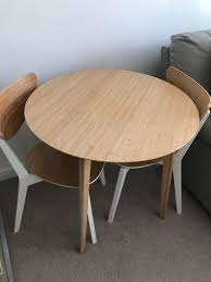 round dining table and 2 matching chairs