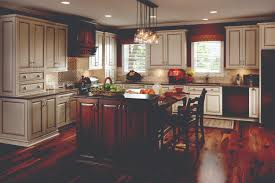 f appealing country kitchen remodeling ideas with pendant lights over dark brown varnish table island set and antique white painted wood l shaped kitchen appealing pendant lights kitchen