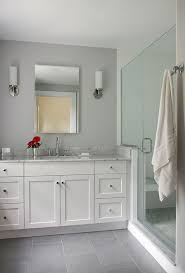 bathroom features gray shaker vanity: darker floors with gray blue paint and white vanity white painted full overlay shaker style custom bath vanity with marble top porcelain tile floor and