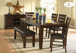 cal dining room with 6 piece dark oak finish wood dining table set bench chairs dark brown leather upholstered dining bench and dark oak finish buffet