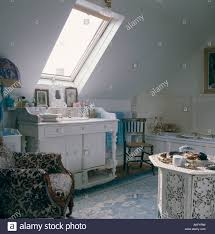 washstand bathroom pine: velux window above basin in painted white washstand in attic bathroom with armchair and spanish rug