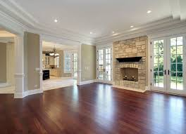 hardwood living room. warm cherry living room hardwood floors up the open area with so much light. love floor plan and paint color too! fireplace could double l