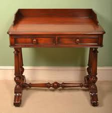 this is a small elegant antique victorian mahogany writing table circa 1860 in