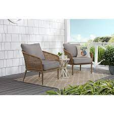 brown wicker outdoor patio dining chair
