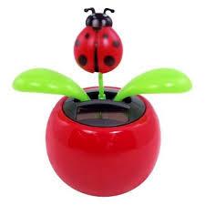 com one solar powered dancing lady bug flower random color toys