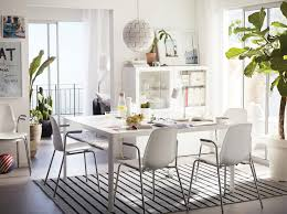 light kitchen table. a light dining room furnished with large white table and four chairs chrome kitchen e