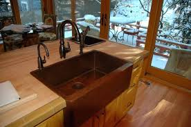 rustic kitchen designed with wooden cabinets and countertops featuring copper sink bronze faucetrustic cabinet faucets