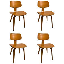 set of four blonde bent plywood dining chairs by thonet for