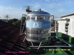 this is a stainless steel water tank with fastened secured lid