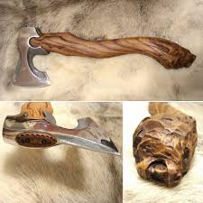 carved axe handle. making an axe handle is old skill from long before you could purchase a pre carved