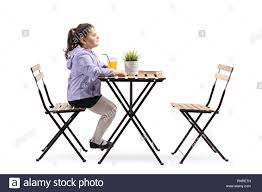 Child Sitting At Table Cut Out Stock Images & Pictures - Alamy