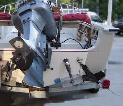 photo stern view of boston whaler outrage 20 hull showing trim tabs mounted on raised