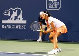 a general interest magazine for south asians in u s   above s tennis sensation awaits a serve from her opponent at the bank of the west classic women s tennis tour nt in stanford calif sania lost