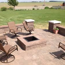 this paver patio is very modern with its straight lines the more traditional round fire