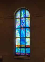 Lighting to penetrate blue stained glass