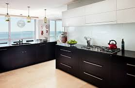 View in gallery Sensible combination of black and white kitchen cabinets