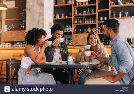 drinking coffee with friends. Brilliant Friends Diverse Group Of Friends Enjoying Some Coffee Together In A Restaurant And  Talking Young People With Drinking Coffee Friends D