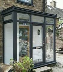 aluminium flat roof porch house with