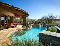southwestern style homeid sized southwest backyard stone and custom shaped natural hot tub photo