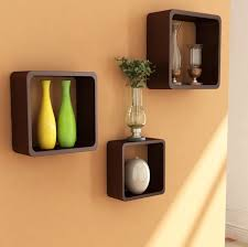 Small Picture three square brown Wood Wall Shelves on cream wall of Magnetizing