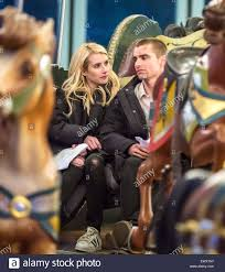 Emma Roberts and Dave Franco film a scene on a carousel for their new Stock  Photo - Alamy