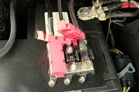 jeep jk electronic accessory setup part 2 wiring fuses relays i made a little tray for the fuse holders which simply snaps into the plastic area beside the battery leaving enough slack in the cables was important so