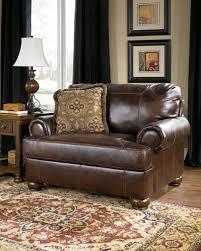 ashley furniture axiom walnut chair and a half to enlarge