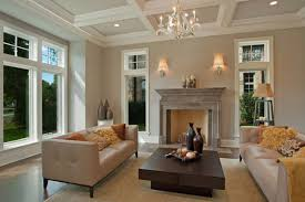 fireplace mantel kits with double white lamp on cream wall plus sofa and pillows