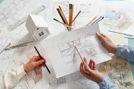 interior design hand drawings. Interior Designers Working On Color Hand Drawings Of A Kitchen At Work Place. Photo Design