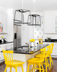 Yellow And White Kitchen White Kitchen With Bright Yellow Stools And Flowers Add Color To