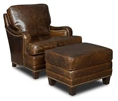 Brown Leather Chair With Low Arm Rest Completed With Stool Also Short Brown  Wooden Legs,
