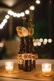 DIY beer bottle centerpieces. Tea candles.