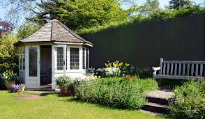 planning advice how to build a summerhouse in your garden without planning consents or complaints from the neighbours