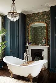 Amazing Bathroom With Wallpaper And Chandelier Over White Clawfoot ...