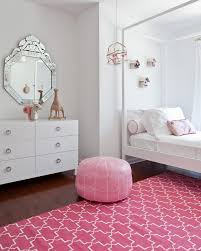 moroccan trellis rug kids transitional with area rug bed bedding dresser pink pouf toys wall mirror