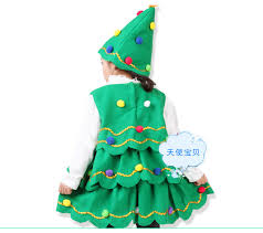Little Girl In The Red Dress Decorating Christmas Tree With Girls Christmas Tree Dress