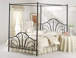 wrought iron bedroom furniture. white floral bedding set and black four poster wrought iron bed frame for english country bedroom ideas furniture