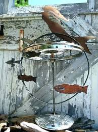 spinning yard art picture large how to make metal dinosaur for garden statues and sculptures