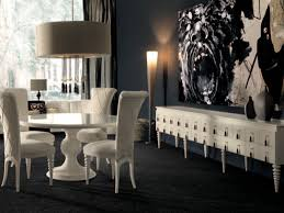 white round dining table. white round dining table in a dark room contemporary-dining-room