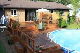 Above ground pool with deck attached to house Sloped Yard Above Ground Pool Deck Attached To House 11 Deckscom Above Ground Pool Deck Attached To House Erosuchkicom
