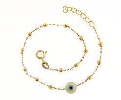 yellow gold evil eye charm bracelet