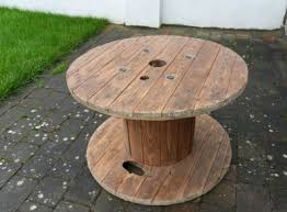 Cable reel, cable spool, table