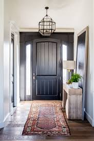 S Entryway With Black Front Door And A Kilim Rug Interiors